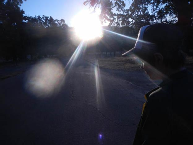 Jackson Masters watches the solstice sun rise through the Avenue of the Sun.