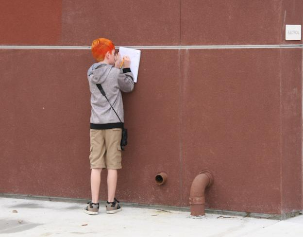 An SLV Middle School student records his observations for Bird School.