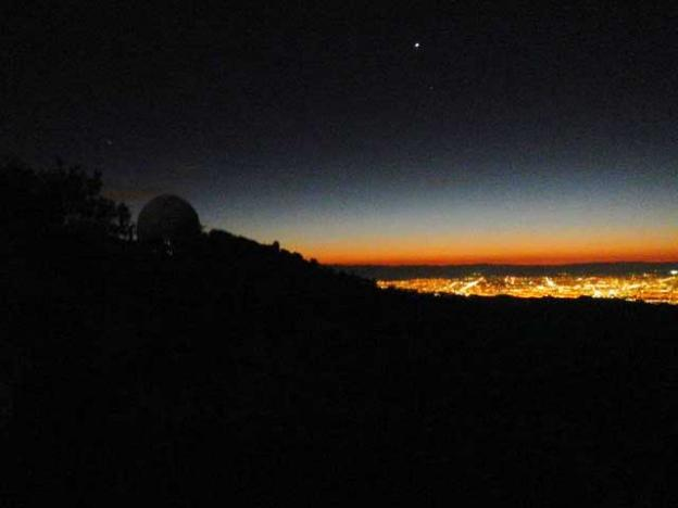 The Lick Observatory overlooks Silicon Valley at night.