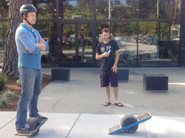 OneWheel creator Kyle Doerksen with a fan outside Future Motion's Santa Cruz headquarters.