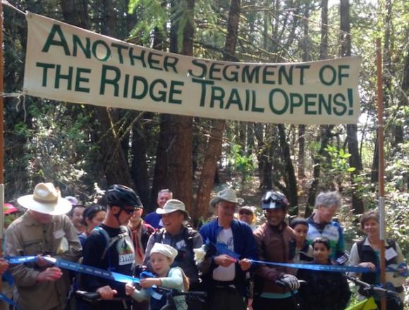 The crowd was rarin' to get that ribbon cut and try out the trail.
