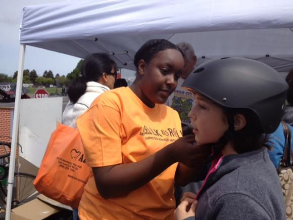 Carefully fitted free helmets were distributed to hundreds of kids.
