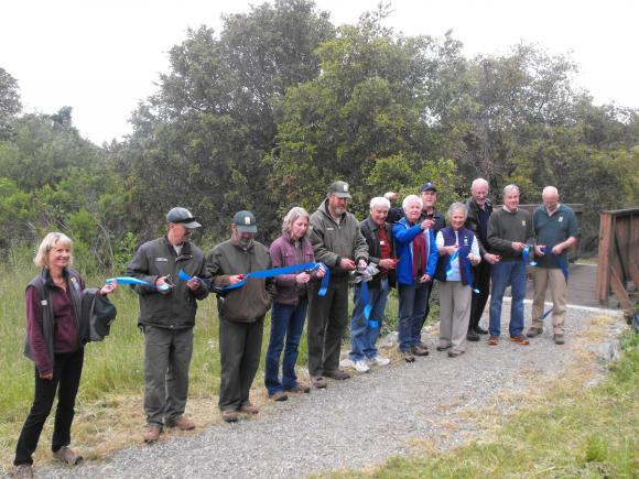 POST and Midpen staff perform the official ribbon-cutting before the guided hike. Hannah Moore photo.