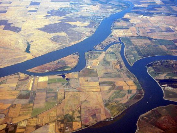 """Aerial view of the Sacramento River Delta. Photo courtesy WorldIslandInfo.org / <a href=""""https://creativecommons.org/licenses/by/2.0/legalcode"""" target=""""_blank"""">CC</a>"""