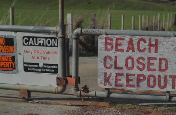 """The gate to Martins Beach is still locked, despite last week's court order to open it. Image from """"Martin's 5: Battle for the Beach,' by The Inertia. (See video below.)"""